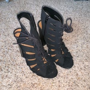 Black lace-up heels with inner zipper